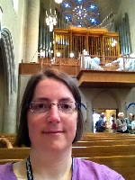 Waiting for the concert to begin. Pipe organ can be seen in the balcony.