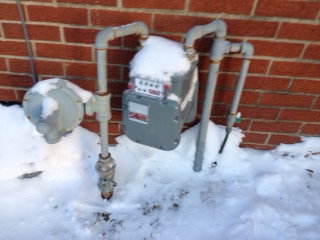 New gas meter with leaking pipe fittings.