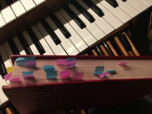 hymnal with tape flags sticking out of side. Each flag is on the page of a hymn I learned long ago.